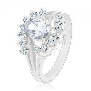 Błyszczący pierścionek w srebrnym odcieniu, przezroczyste łuki, cyrkoniowy owal obraz