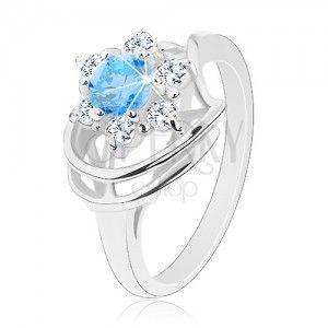 Błyszczący pierścionek, niebiesko-przezroczysty cyrkoniowy kwiatek, lśniące łuki obraz