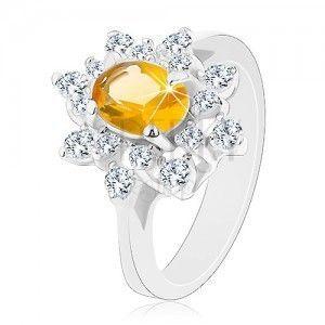 Pierścionek srebrnego koloru, błyszczący kwiat z cyrkonii żółtego i bezbarwnego koloru obraz