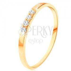 Złoty pierścionek 585 - cienkie lśniące ramiona, linia czterech przezroczystych cyrkonii obraz