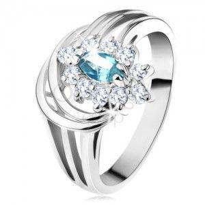 Lśniący pierścionek z rozgałęzionymi ramionami, jasnoniebieskie cyrkoniowe ziarenko, łuki obraz