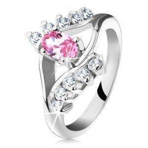 Błyszczący pierścionek z cyrkoniowym różowo-przezroczystym oczkiem, rozdwojone ramiona obraz