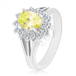 Błyszczący pierścionek z rozgałęzionymi ramionami, srebrny kolor, żółto-przezroczyste cyrkonie obraz