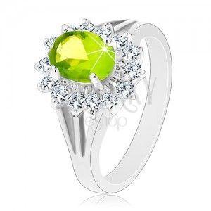 Błyszczący pierścionek z rozdzielonymi ramionami, cyrkoniowy owal zielonego koloru obraz