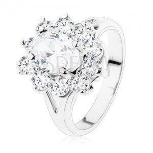 Błyszczący pierścionek srebrnego koloru, rozdwojone ramiona i przezroczyste cyrkonie obraz
