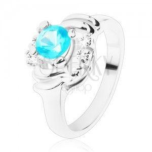 Błyszczący pierścionek z przezroczystymi łukami, jasnoniebieska okrągła cyrkonia, półksiężyce obraz