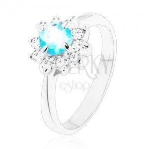 Lśniący pierścionek o wąskich ramionach, jasnoniebieska okrągła cyrkonia, przezroczysta cyrkoniowa oprawa obraz