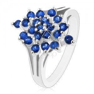 Lśniący pierścionek - srebrny kolor, rozgałęzione ramiona, ciemnoniebieskie okrągłe cyrkonie obraz