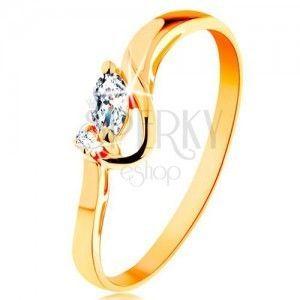 Złoty pierścionek 585 - przezroczyste wyszlifowane ziarnko i okrągła cyrkonia, lśniący łuk obraz
