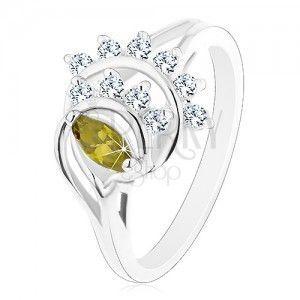 Lśniący pierścionek, łuki otoczone liniami przezroczystych cyrkonii, zielone ziarnko obraz