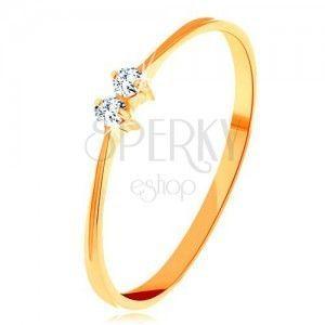 Złoty pierścionek 585 - cienkie lśniące ramiona, dwie połyskliwe cyrkonie bezbarwnego koloru obraz