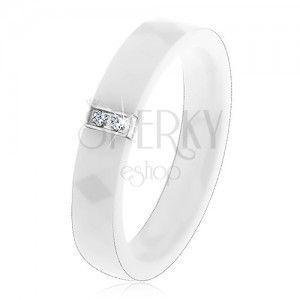 Biały ceramiczny pierścionek o wyszlifowanej powierzchni, stalowy prostokąt z cyrkoniami obraz