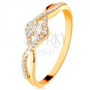 Złoty pierścionek 585 - przeplecione rozdwojone ramiona, przezroczysty cyrkoniowy kwiatek obraz