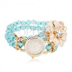 Zegarek na rękę z niebieskich koralików, cyferblat z cyrkoniami, biały kwiat obraz