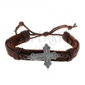 Skórzana bransoletka brązowego koloru ze sznurkami, ozdobnie powycinany duży krzyż obraz