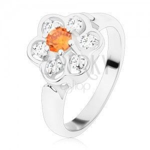 Pierścionek w srebrnym odcieniu, błyszczący przezroczysty kwiatek z pomarańczowym środkiem obraz