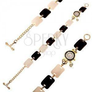 Czarno-biały zegarek na rękę, wypukłe prostokąty, cyferblat z bezbarwnymi cyrkoniami obraz