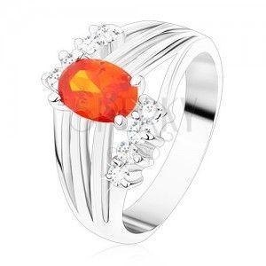 Błyszczący pierścionek srebrnego koloru, pomarańczowa owalna cyrkonia, lśniące pasy, bezbarwne cyrkonie obraz