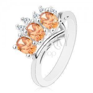Pierścionek srebrnego koloru, pomarańczowe owale i okrągłe bezbarwne cyrkonie obraz