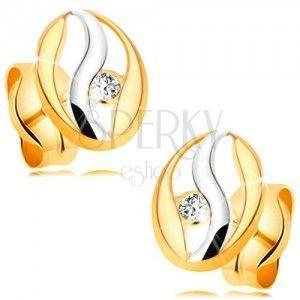 Diamentowe kolczyki z 14K złota - zarys owalu z falą z białego złota, brylant obraz