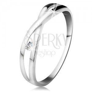 Pierścionek z białego złota 585 - okragły diament bezbarwnego koloru, rozdzielone skrzyżowane ramiona obraz
