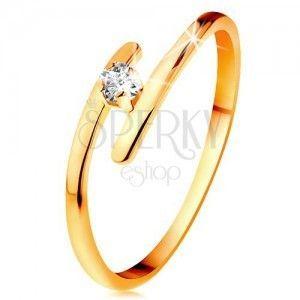 Diamentowy pierścionek z żółtego 14K złota - błyszczący bezbarwny brylant, cienkie przedłużone ramiona obraz
