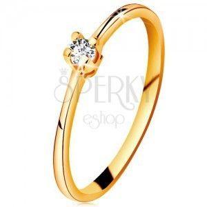 Złoty pierścionek 585 - błyszczący przezroczysty brylant w czteroramiennym koszyczku, zwężone ramiona obraz
