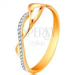 Złoty pierścionek 585, asymetryczne przeplecione fale - dwie gładkie i jedna cyrkoniowa obraz