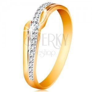 Błyszczący złoty pierścionek 585 - bezbarwna cyrkonia między końcami ramion, cyrkoniowa fala obraz