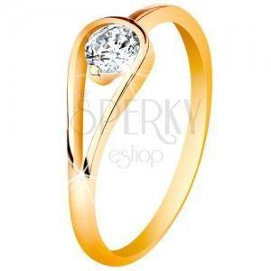 Złoty 585 pierścionek o wąskich lśniących ramionach, bezbarwna cyrkonia w pętelce obraz