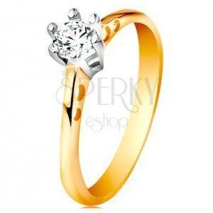 Złoty 585 pierścionek - okrągłe wycięcia na ramionach, bezbarwna cyrkonia w koszyczku z białego złota obraz