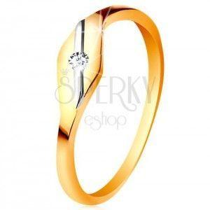 Złoty pierścionek 585 - lśniące ziarnko, ukośna linia z białego złota i bezbarwna cyrkonia obraz