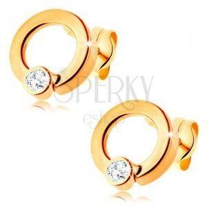 Złote diamentowe kolczyki 585 - lśniące koło z brylantem bezbarwnego koloru obraz