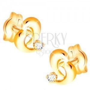 Brylantowe złote kolczyki 585 - kontur nieregularnego serca, diament bezbarwnego koloru obraz