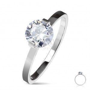 Stalowy pierścionek zaręczynowy srebrnego koloru, okrągła bezbarwna cyrkonia, lśniące ramiona obraz