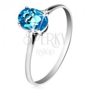 Złoty pierścionek 585, owalny lśniący topaz niebieskiego koloru, cienkie ramiona obraz