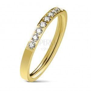 Stalowy pierścionek złotego koloru, linia bezbarwnych cyrkonii, lśniąca powierzchnia, 2, 5 mm obraz