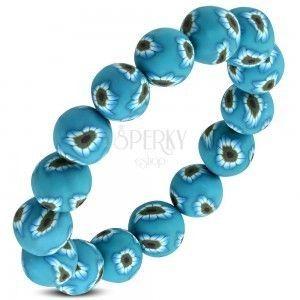Elastyczna bransoletka FIMO, niebieskie koraliki z kwiatkami na gumce obraz