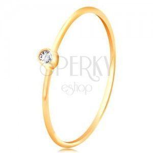 Złoty diamentowy pierścionek 585 - błyszczący bezbarwny brylant w okrągłej oprawie, cienkie ramiona obraz