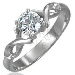 Zaręczynowy pierścionek z cyrkonią i podwójną stalową wstążką obraz