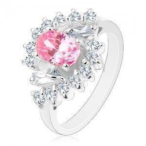 Pierścionek w srebrnym odcieniu, wyszlifowany owal różowego koloru, przezroczyste cyrkoniowe łuki obraz