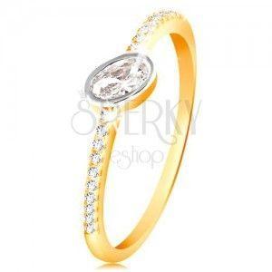 Złoty pierścionek 585 - bezbarwna owalna cyrkonia w oprawie z białego złota, cyrkoniowe linie obraz