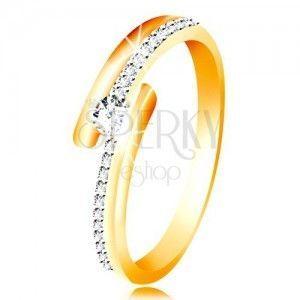 Złoty pierścionek 585 - rozdwojone ramiona, uniesiona okrągła cyrkonia bezbarwnego koloru obraz
