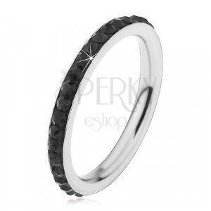Stalowy pierścionek srebrnego koloru, błyszczące czarne cyrkonie obraz