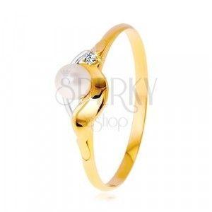 Diamentowy pierścionek z 14K złota, dwukolorowe fale, bezbarwny brylant i biała perła obraz