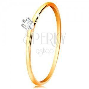 Złoty pierścionek 585 - bezbarwna cyrkonia w koszyczku z białego złota, cienkie ramiona obraz