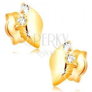 Diamentowe kolczyki wykonane z żółtego 14K złota - dwa bezbarwne brylanty, błyszczący listek obraz
