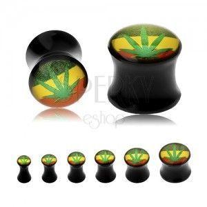 Czarny siodłowy plug do ucha, zielona marihuana, tło w rasta kolorach obraz