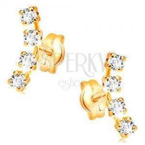 Kolczyki z żółtego 14K złota - łuk z czterech małych przezroczystych cyrkonii obraz