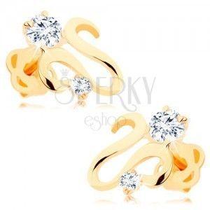 Kolczyki w żółtym 14K złocie - lśniąca falista wstążka, dwie cyrkonie bezbarwnego koloru obraz
